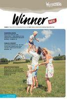 Die Titelseite des Winner-Magazins zeigt eine fröhliche Familie vor der St. Georg Sprungschanze.
